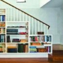 Staircase landing with a cozy reading space with a bookshelf